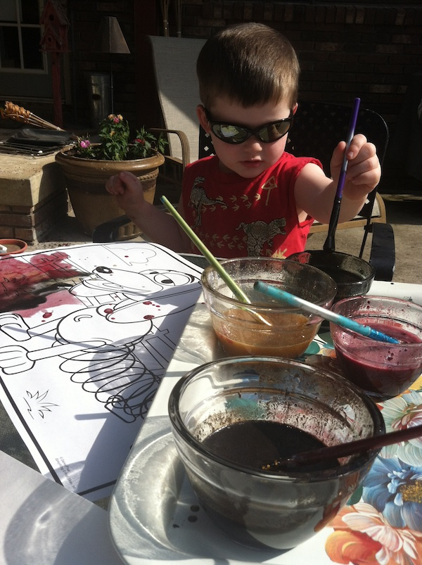 Inspiring boy with paint