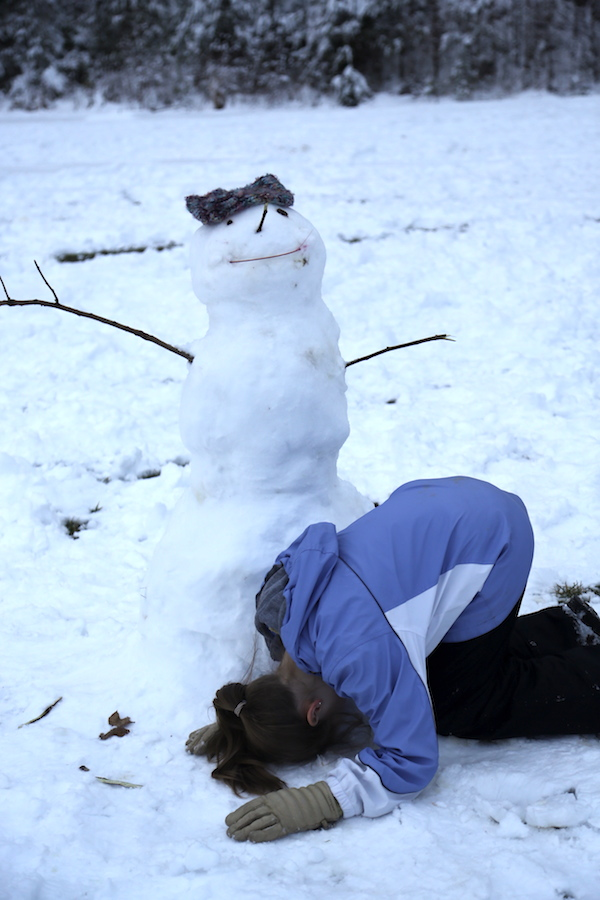 Snowman + on her knees